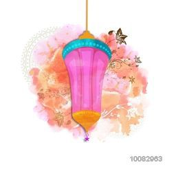 Colourful creative Lantern on splash and floral background for Islamic Festivals celebration.