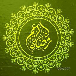 Elegant Greeting Card design with Arabic Islamic Calligraphy of text Ramada Kareem in ornamental frame on shiny green background.