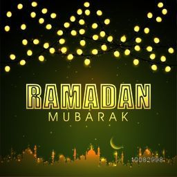 Illuminated lights and Glowing Mosque decorated greeting card design for Islamic Holy Month of Prayers, Ramadan Kareem celebration.