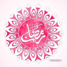 Beautiful floral design decorated, Greeting Card with Arabic Islamic Calligraphy of text Ramadan Kareem on pink background.