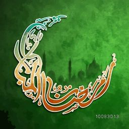 Creative Arabic Islamic Calligraphy of text Ramazan-Ul-Mubarak in crescent moon shape on mosque silhouetted green background.