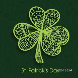 Beautiful floral design decorated creative Shamrock Leaf on green background for Happy St. Patrick's Day celebration.