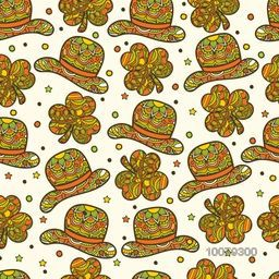 Creative seamless pattern with floral design decorated shamrock leaves and leprechaun hats for Happy St. Patrick's Day celebration.