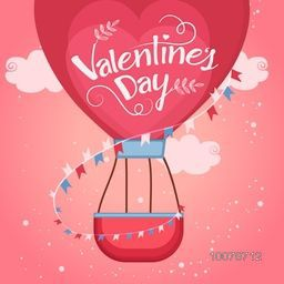 Red beautiful heart shaped hot air balloon flying in glossy cloudy background for Happy Valentine's Day celebration.