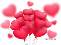 Beautiful glossy balloons in pink heart shape for Happy Valentine's Day celebration.