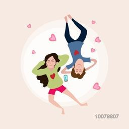 Young couple listening music on pink hearts decorated background for Happy Valentine's Day celebration.