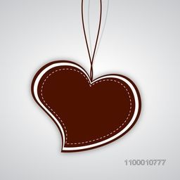 Valentines Day background with sticky or tag in heart shape on grey background. EPS 10.