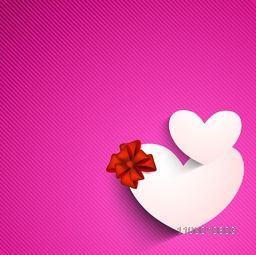 Valentines Day background with sticky, label or tag in heart shape on pink background.
