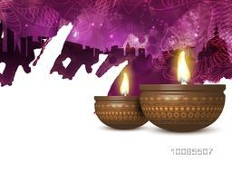 Creative realistic illuminated Oil Lamps (Diya) on floral design decorated, temple silhouetted background, Beautiful abstract pattern, Elegant Greeting Card for Indian Festival of Lights, Happy Diwali celebration.