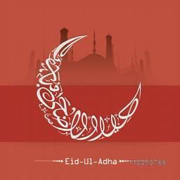 Arabic Islamic Calligraphy of text Eid-Ul-Adha in crescent moon shape on mosque silhouetted background.