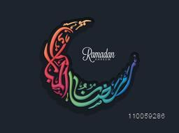 Colorful Arabic Islamic calligraphy of text Ramazan-ul-Kareem (Happy Ramadan) in crescent moon shape for Muslim community festival celebration.