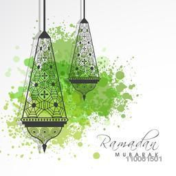 Floral decorated traditional arabic lamps or lanterns with green color splash for holy month of muslim community, Ramadan Kareem celebration.