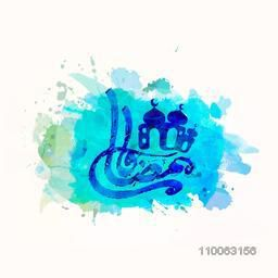 Arabic Islamic calligraphy of text Ramadan Kareem with mosque painted by blue ink on color splash background for Islamic holy month of prayers, Ramadan Kareem celebration.