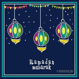 Creative colorful hanging lanterns with bunting decoration on stars decorated blue background, Elegant greeting card design for Islamic holy month, Ramadan Mubarak celebration.