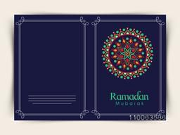 Blue greeting card design decorated with beautiful traditional floral pattern for Islamic holy month of prayers, Ramadan Mubarak celebration.