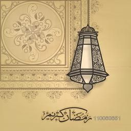 Traditional hanging lantern with Arabic Islamic calligraphy of text Ramadan Kareem on beautiful floral design decorated background for Muslim community festival celebration.
