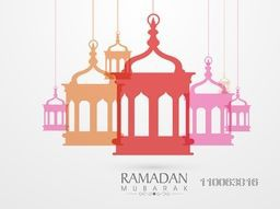 Greeting card design with colorful hanging arabic lamps or lanterns for islamic holy month of prayer celebration.
