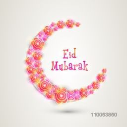 Colorful glossy flowers decorated creative crescent moon for muslim community festival of Eid Mubarak celebration.