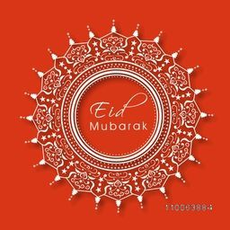 Stylish text Eid Mubarak in floral decorated beautiful frame on orange background for muslim community festival celebration.