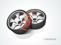 Shiny car wheels with fire flames on floor background.