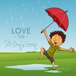 Cute little boy holding an umbrella and dancing in rains on nature background for Monsoon Season.