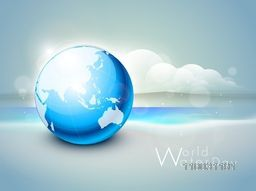 Glossy stylish globe on nature view background for World Water Day concept.
