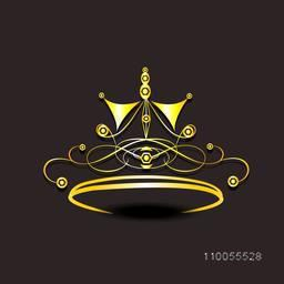Shiny golden crown isolated on dark brown background.