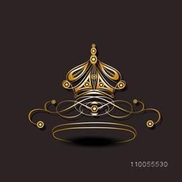 Shiny stylish crown isolated on dark brown background.