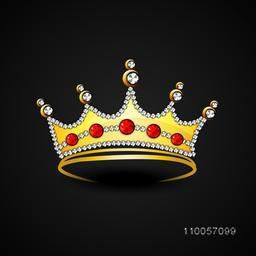 Stylish gold crown decorative with diamond on black background.