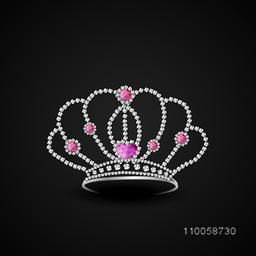 Diamond crown decorative with jewel and pink sapphire on black background.