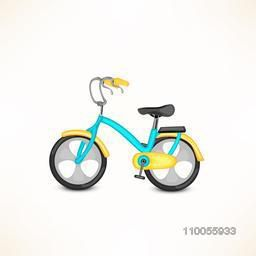 Colourful transport toy bicycle on white background.