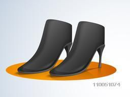 Women's boot over orange colour circle on stylish background.
