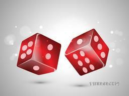 Glossy dices in red color on stylish grey background.