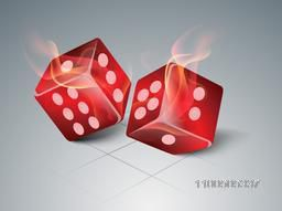 Glossy red dices in fire flames on abstract grey background.