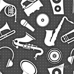 Different musical instrument on seamless dotted dark grey color background.