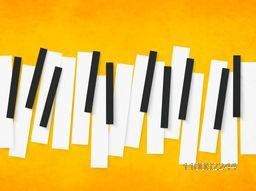 Music concept with black and white piano keys on yellow background.
