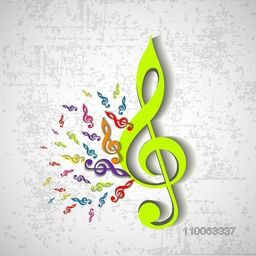 Colorful musical notes on grungy grey background.