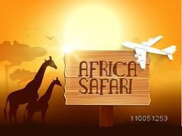 Stylish text of Africa Safari on a wooden plate for showing travel on shiny orange nature  background.