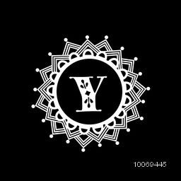 Shiny English Alphabet Y in beautiful floral pattern decorated rounded frame for monogram design  on black background.