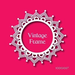 Floral design decorated beautiful rounded vintage frame on glossy pink background.