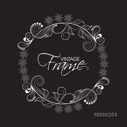Beautiful floral design decorated vintage frame in circle shape on black background.