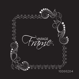Stylish square shaped vintage frame decorated with beautiful floral pattern on black background.