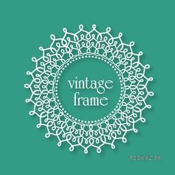 Floral design decorated beautiful rounded vintage frame on green background