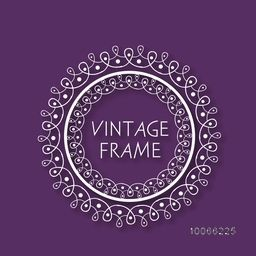 Floral design decorated beautiful rounded vintage frame on purple background.