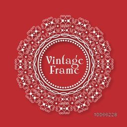 Floral design decorated beautiful rounded vintage frame on red background.