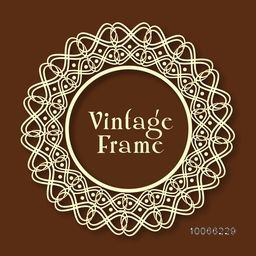 Beautiful floral design decorated rounded vintage frame on glossy brown background.