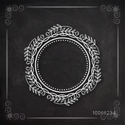 Floral design decorated beautiful rounded vintage frame with leaves on blackboard background.