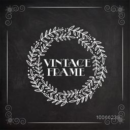 Creative stylish vintage frame with stylish leaves decorated on blackboard background