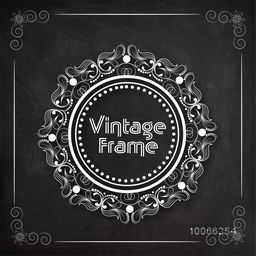 Beautiful floral design decorated rounded shape vintage frame created by white chalk on blackboard background.