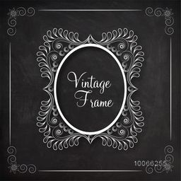 Stylish oval shape vintage frame decorated by floral design on blackboard background.